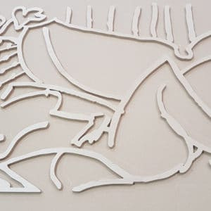 CNC cut Birch Plywood wall art showing a naked lady laying down