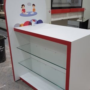 Red and white laminated bespoke point of sale display made for IDA Institute