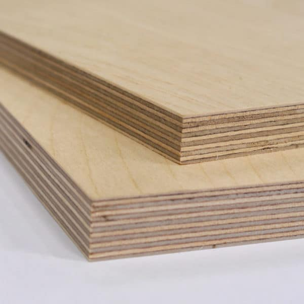 A composed photo showing tow piece of Birch Plywood cut to size and stacked on top of each other. The top piece is 12mm thick Birch Plywood, the bottom piece is 18mm thick Birch Plywood.