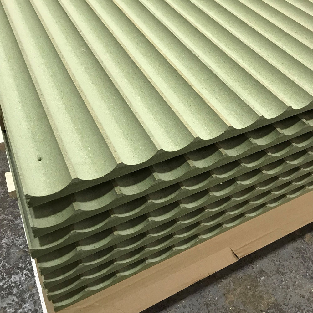 A stack of seven fluted moisture resistant MDF cut on a CNC router