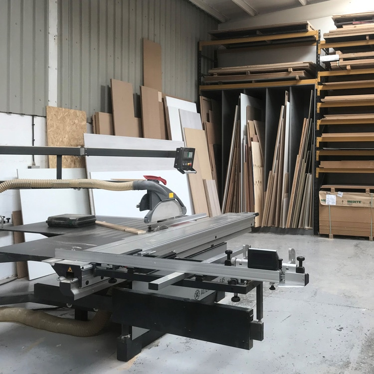 An Altendorf F45 panel dimensioning saw sitting in front of an off cut rack in a workshop