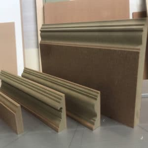 """A selection of four MR MDF exact match Victorian mouldings from left to right a door stop picture rail architrave and 12"""" skirting"""