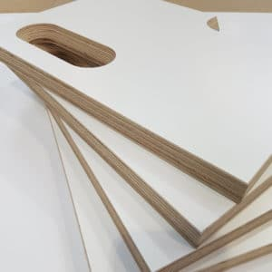 Four white melamine faced birch plywood CNC kitchen door handle samples