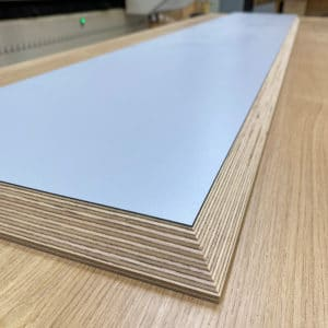 The underside of a pale blue laminated Birch Plywood shelf with 30 degree chamfered edge detail