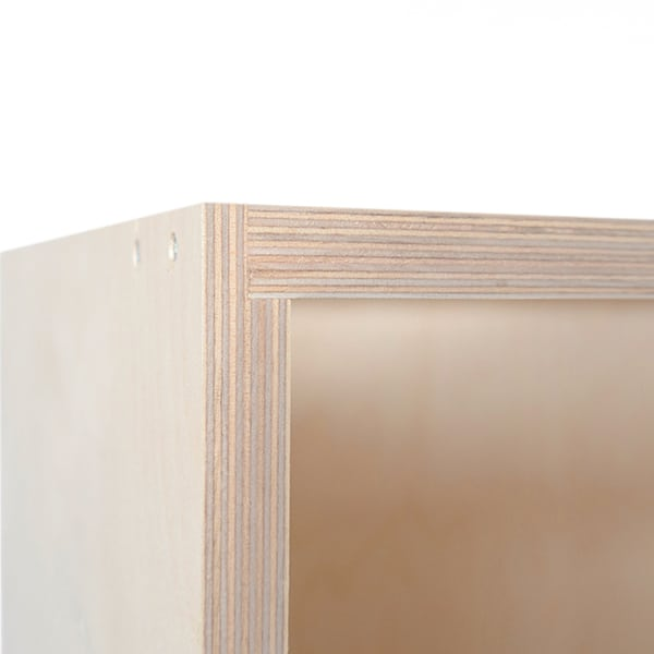 A close up photo showing the corner detail of a birch plywood kitchen cabinet