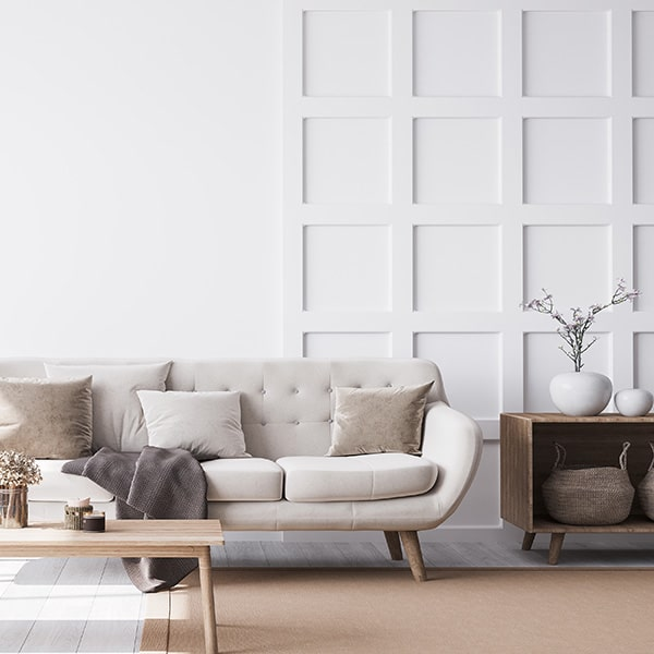 A lounge area with white shaker style wall panelling