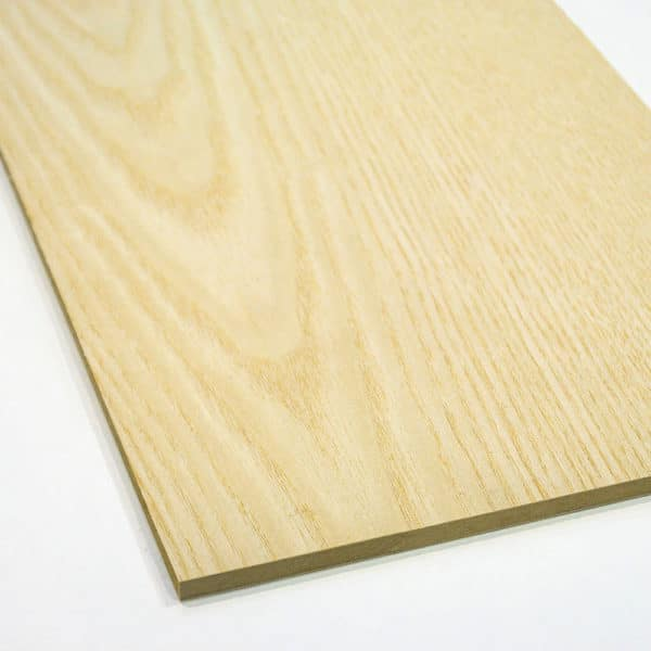 Ash veneered MDF board on a white background