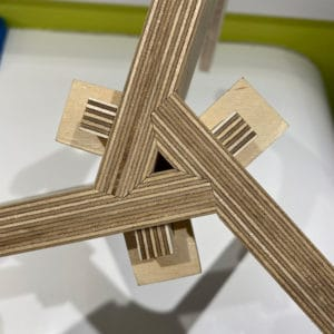 A close up photo showing a complex joint for a birch plywood plant stand