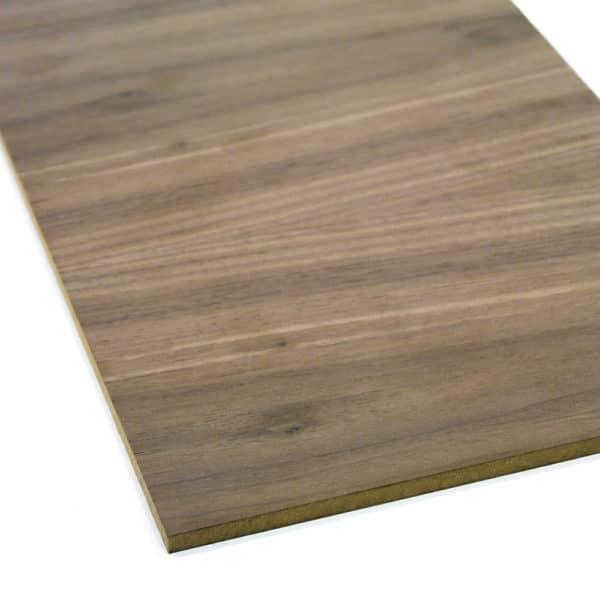 Walnut veneer MDF board on a white background