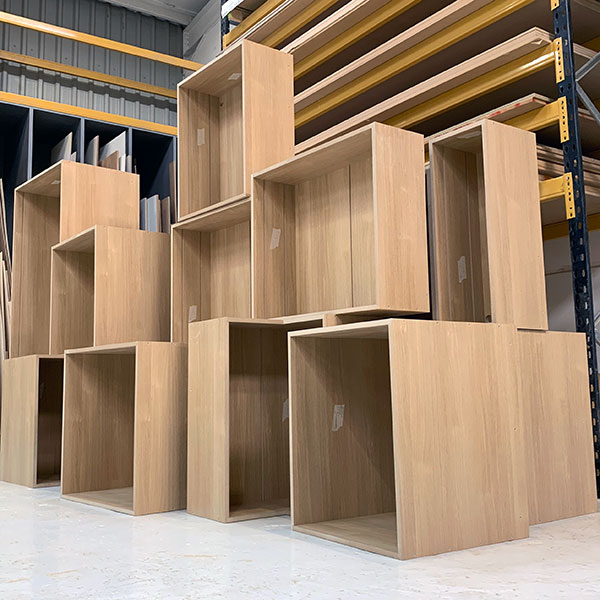A stack of Oak melamine faced MDF kitchen carcasses ready to be despatched to a bespoke kitchen company